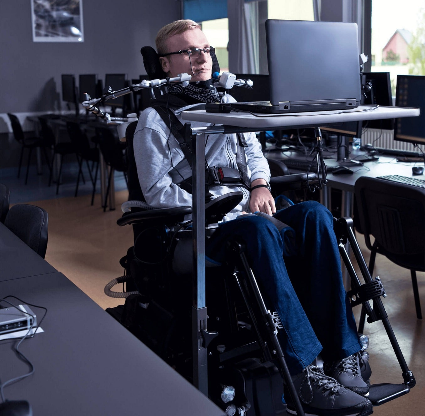 Photo of Disabled Person Using Voice Controls to Manage a Computer
