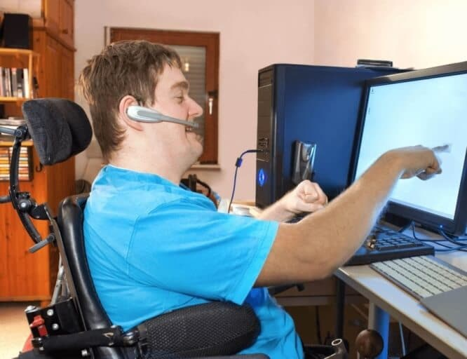 Disabled Person Touching a PC Monitor